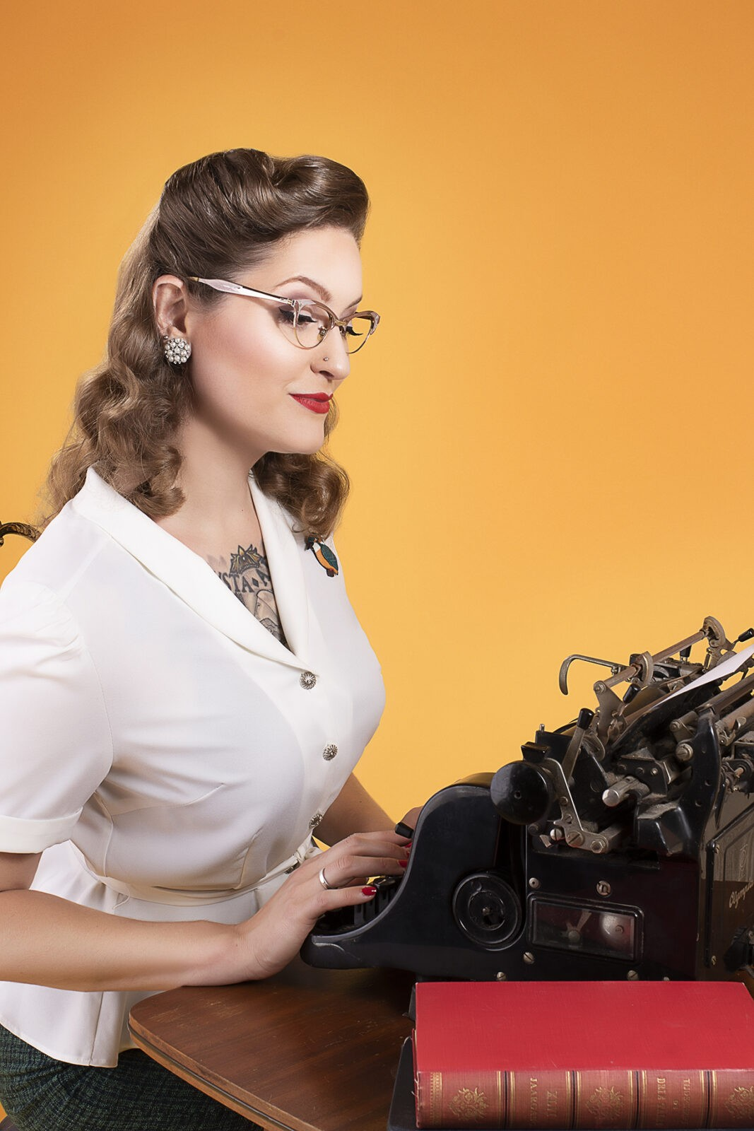 Pieta typing at a typewriter